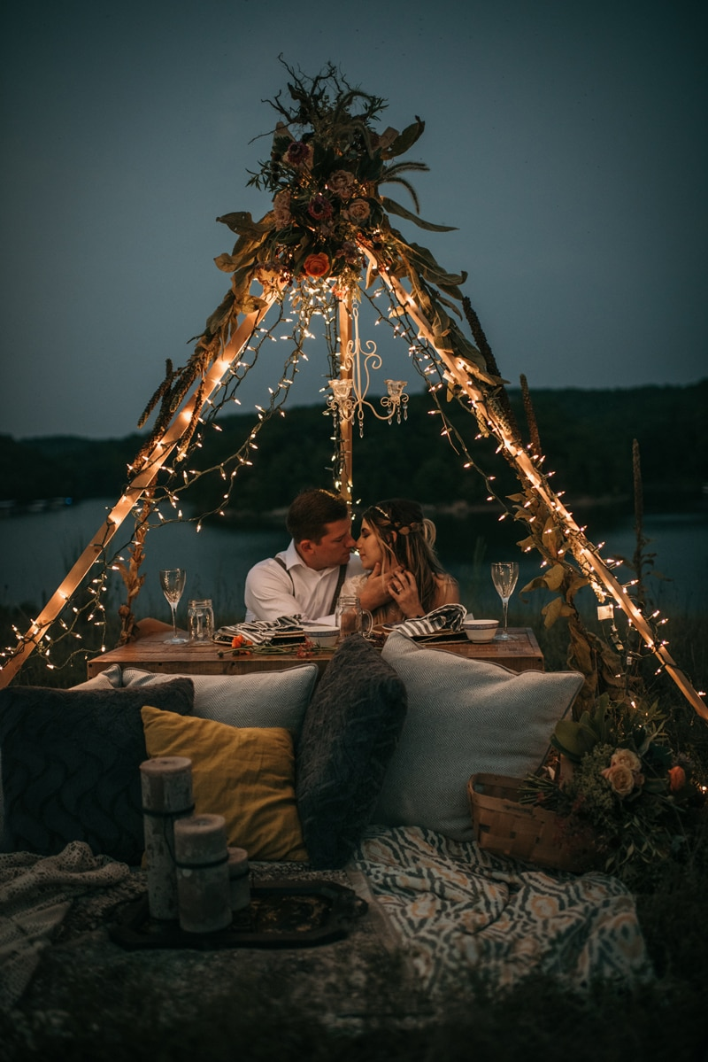 Wedding Photography, couple having dinner outside under a teepee of lights