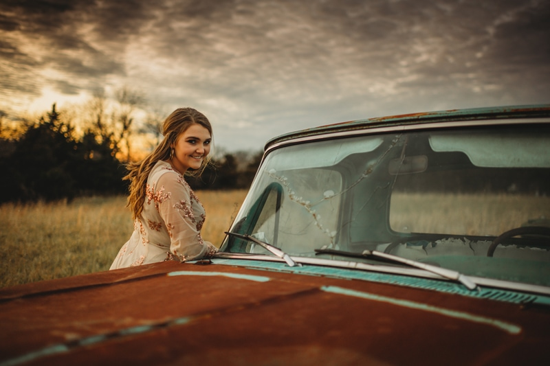 Senior Photography, girl leaning over the hood of a truck
