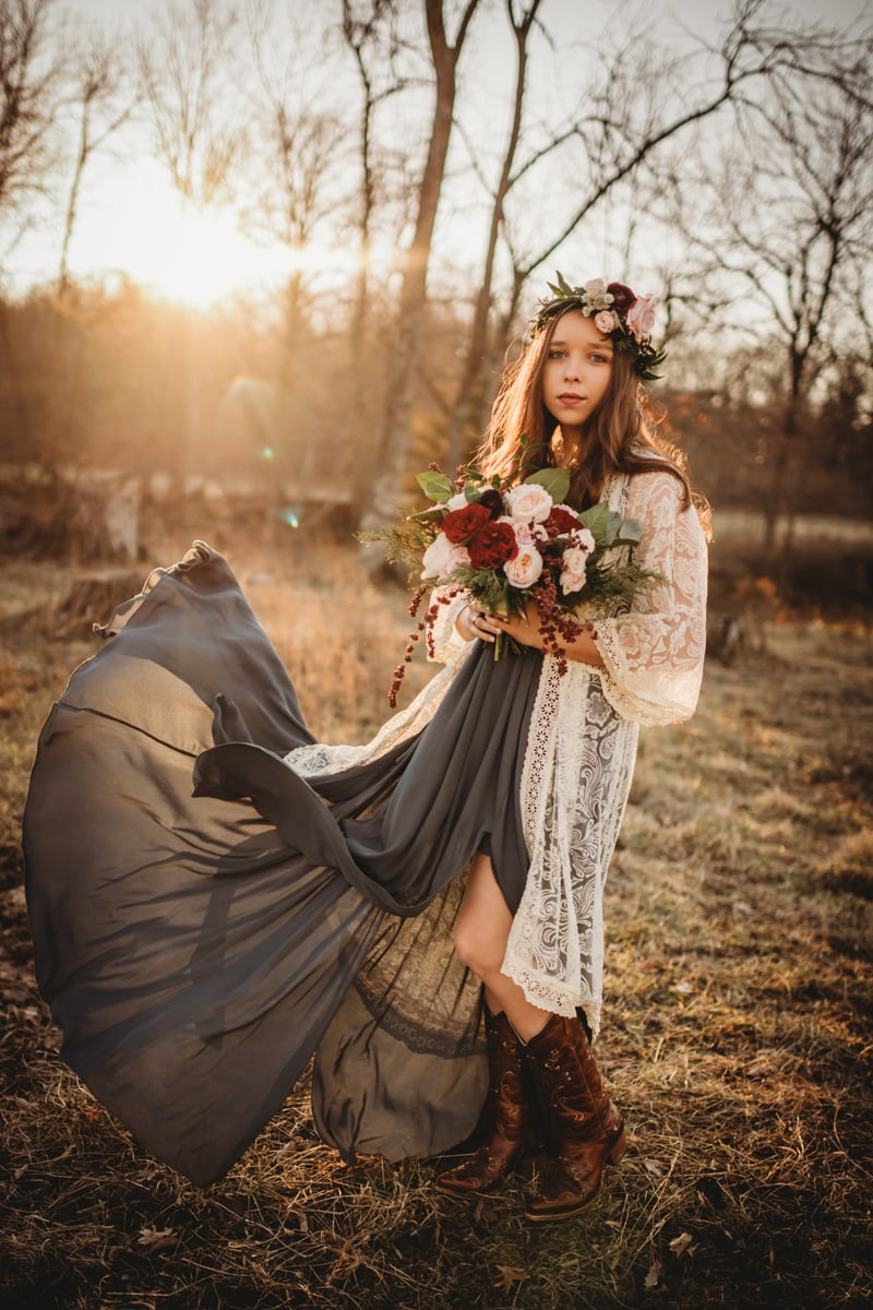 Senior Photography, girl holding a bouquet of pink and dark red flowers looking at the calendar
