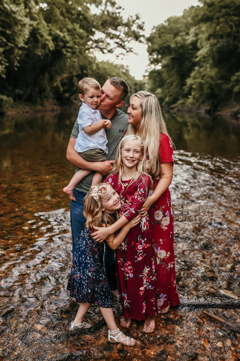 Family Photography, family of 5 standing in a creek together