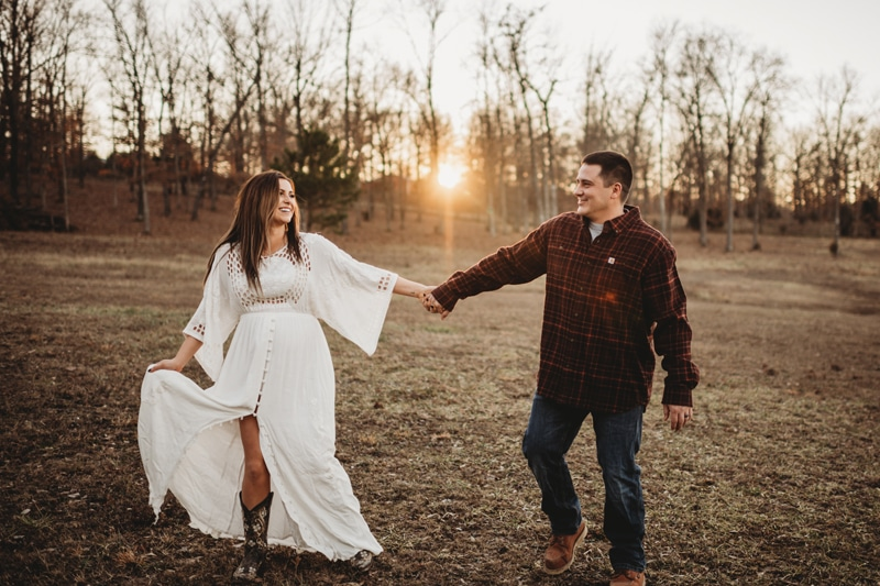 Couples Photography, couple holding hands in a field