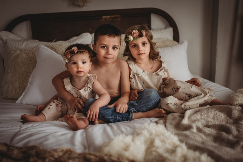 Children Photography, three siblings sitting on the bed together