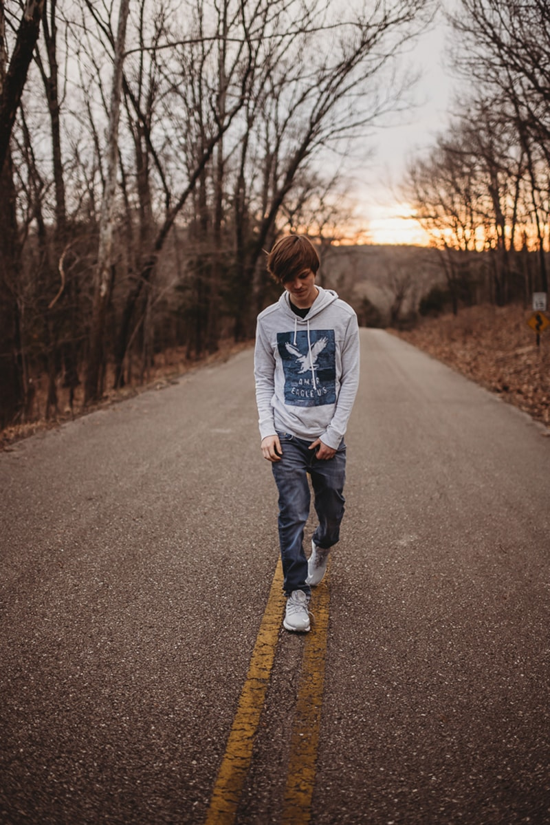 Senior Photography, boy walking down the street