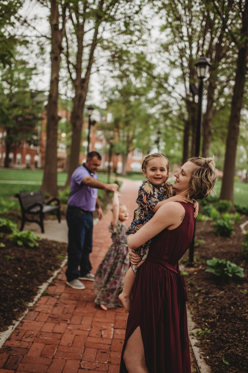 Family Photography, family of 4 playing together on a brick pathway