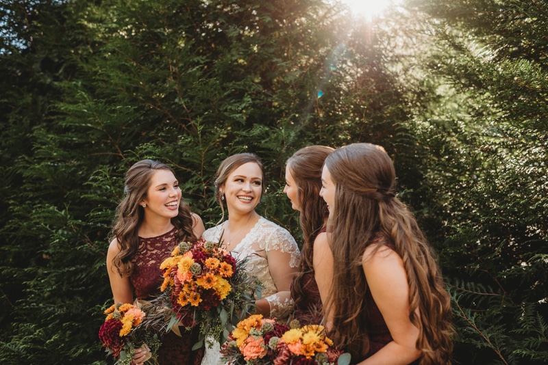 Wedding Photography, bride and bridesmaids laughing together