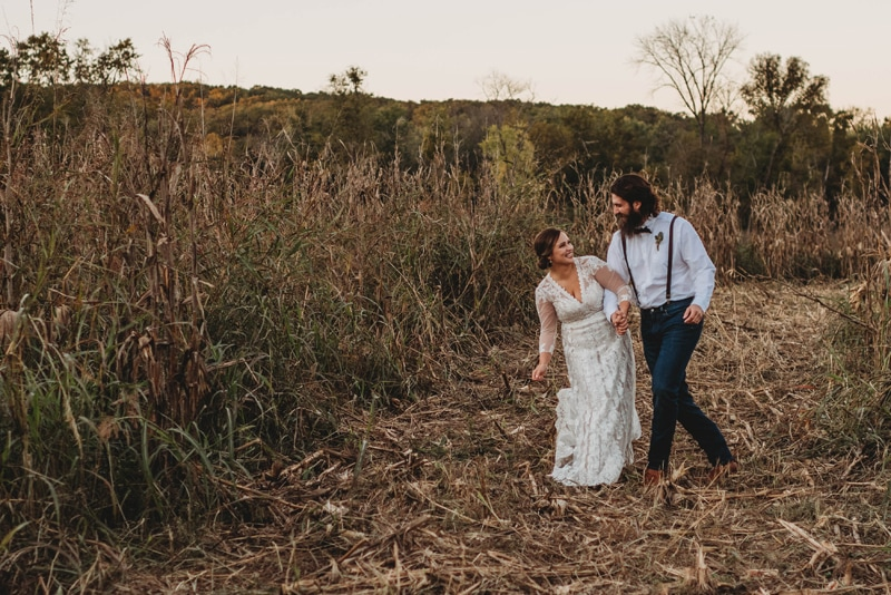 Wedding Photography, bride and groom walking through really tall grass