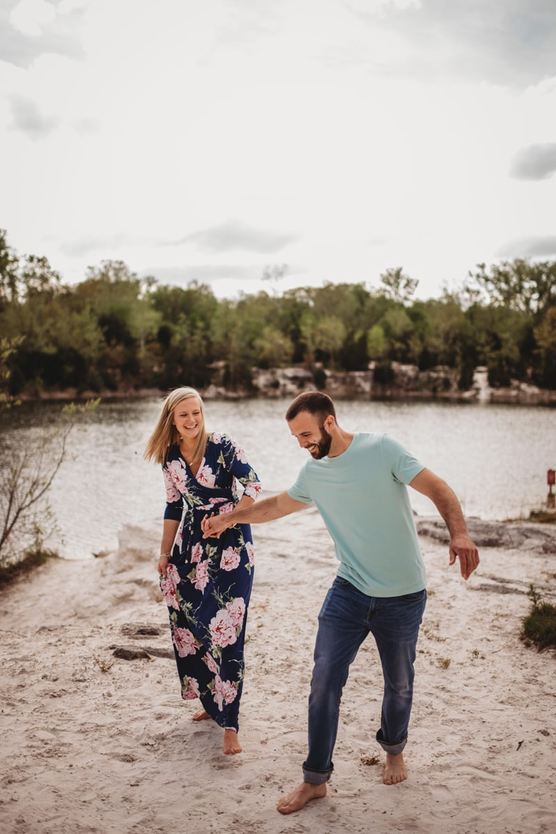 Couples Photography, couple laughing together at the water's edge