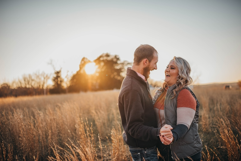 Couples Photography, couple laughing together in a field of tall grass