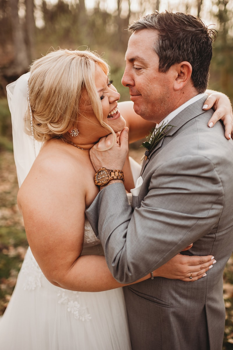 Wedding Photography, Groom making his new bride laugh