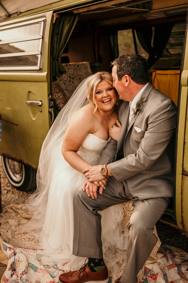 Wedding Photography, bride and groom sitting in a vw van