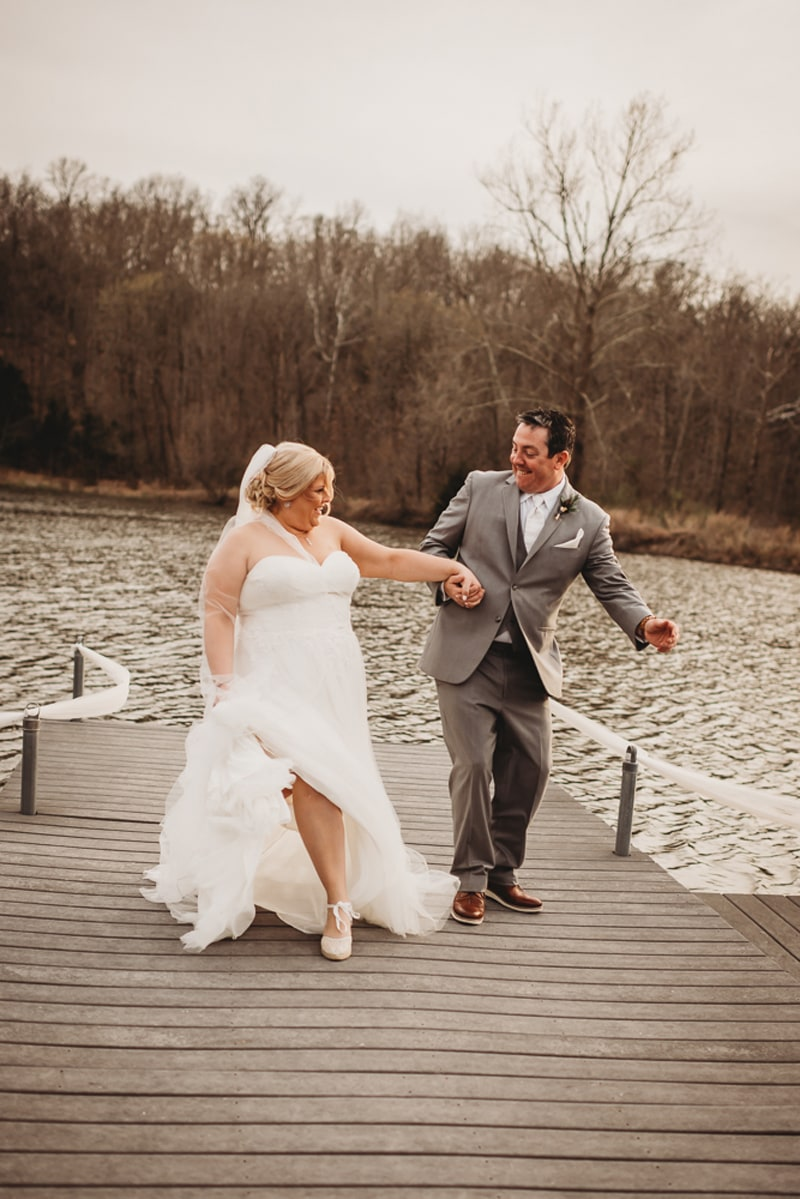 Wedding Photography, bride and groom running up a pier