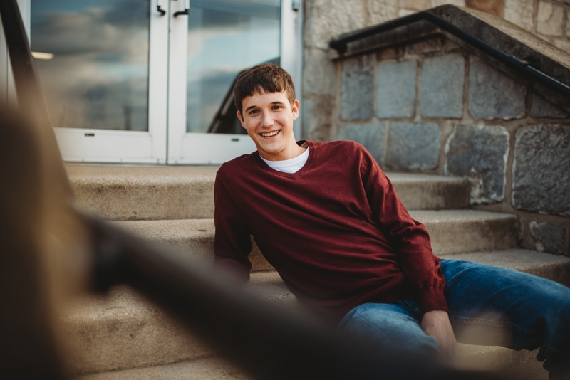 Senior Photography, boy leaning on stairs