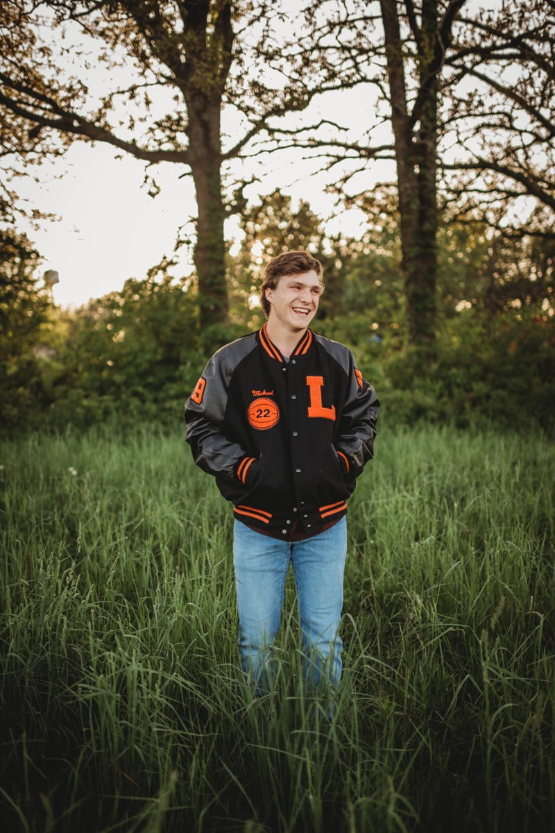 Senior Photography, boy in letterman jacket