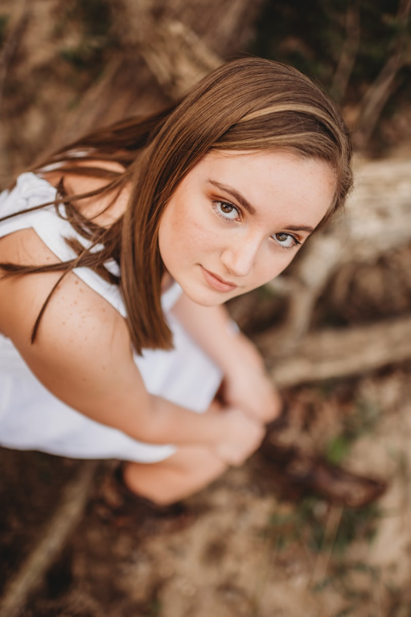 Senior Photography, girl in white looking up at camera