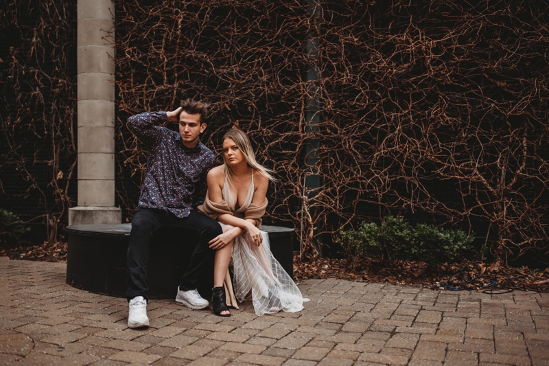 Couples Photography, sitting on a ledge together