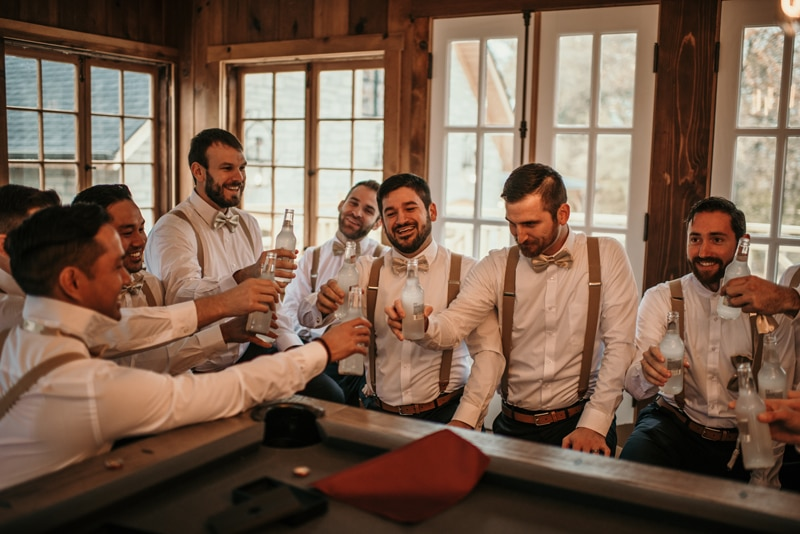 Wedding Photography, groom and groomsmen having a drink together