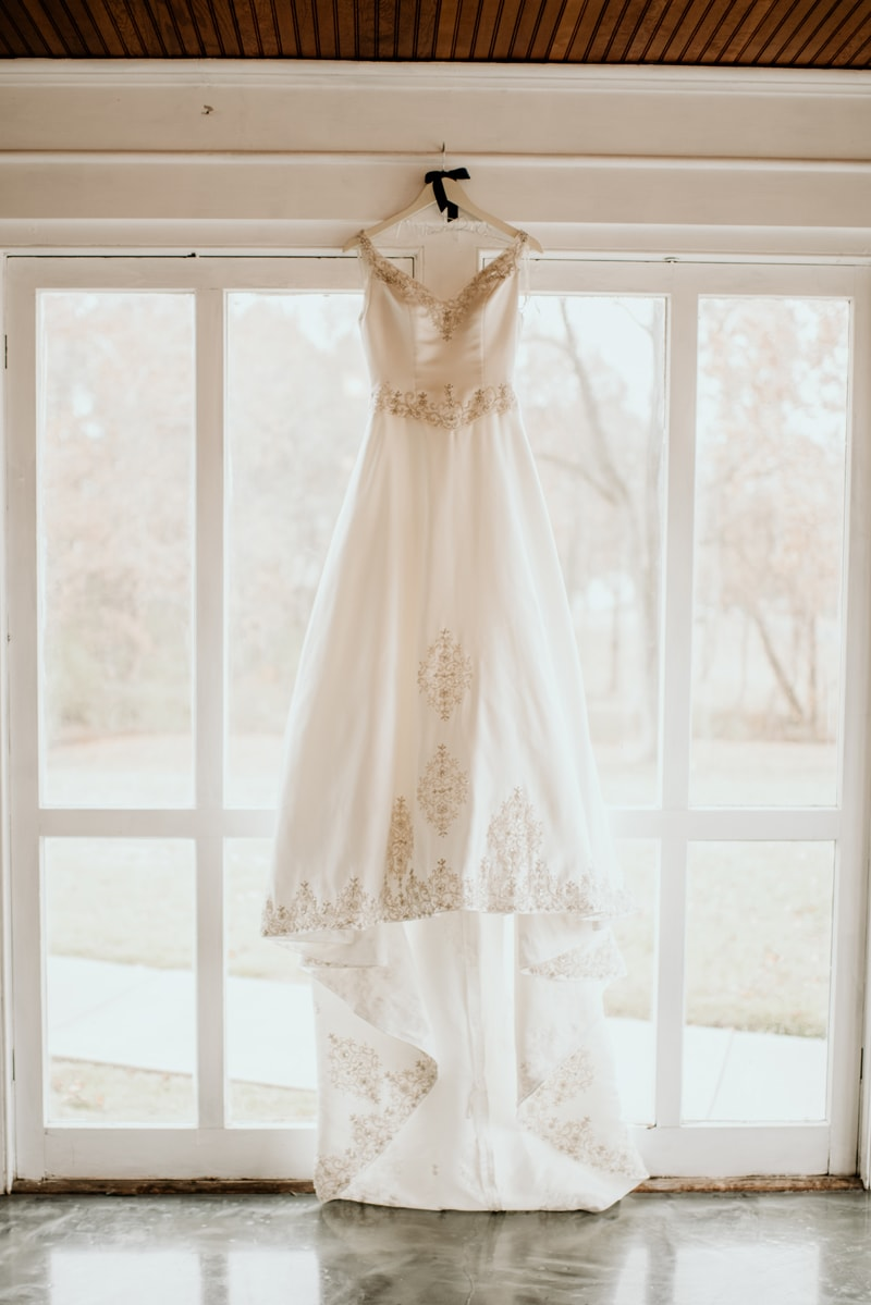 Wedding Photography, wedding dress hanging up in front of windows