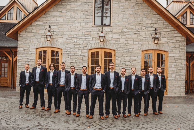 Wedding Photography, large groomsmen group standing in front of wedding venue
