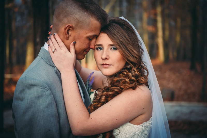 Wedding Photography, bride and groom, with woman looking at the camera