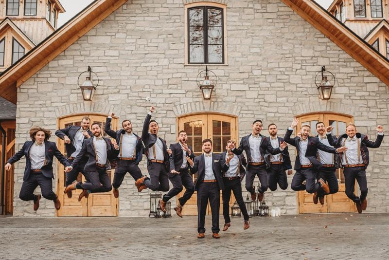 Wedding Photography, groomsmen jumping around the groom
