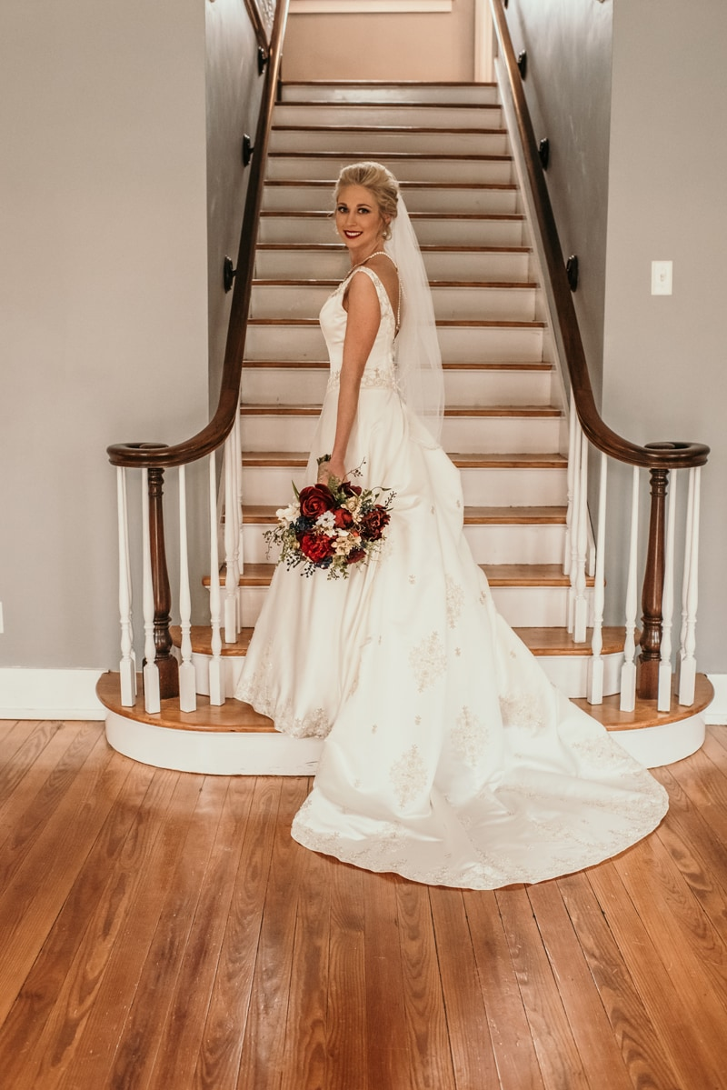 Wedding Photography, bride posing at the bottom of stairs