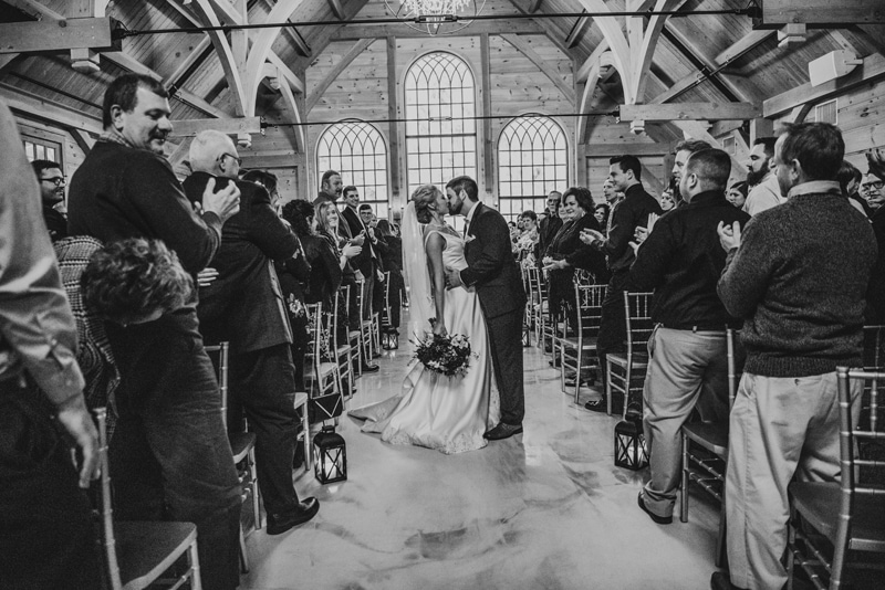 Wedding Photography, husband and wife kissing in the church
