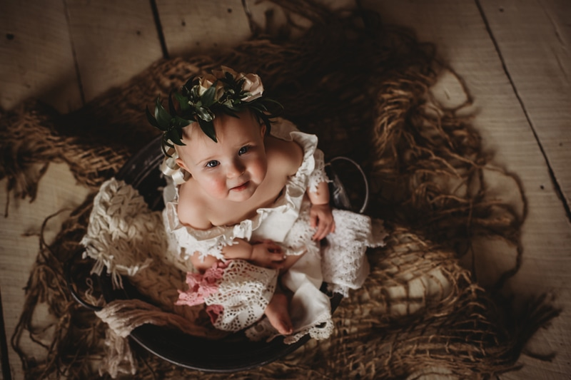 Children Photography, baby looking up at camera with flower crown