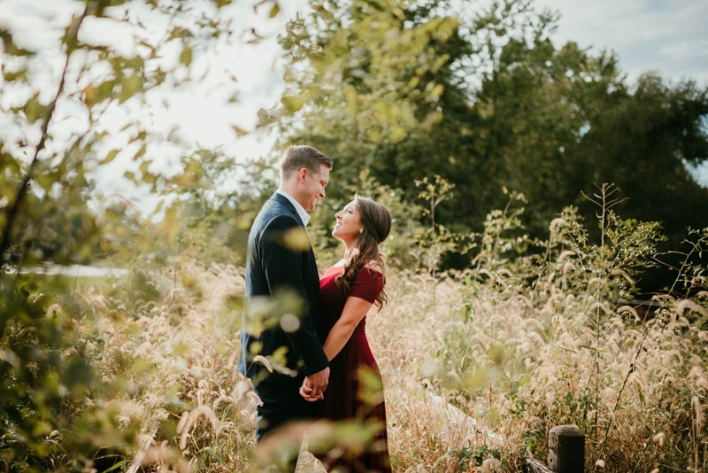 Couples Photography, couple standing together next to an old wodden fence