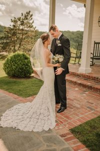 Wedding Photography, Bride and Groom standing on brick pathway outside of home