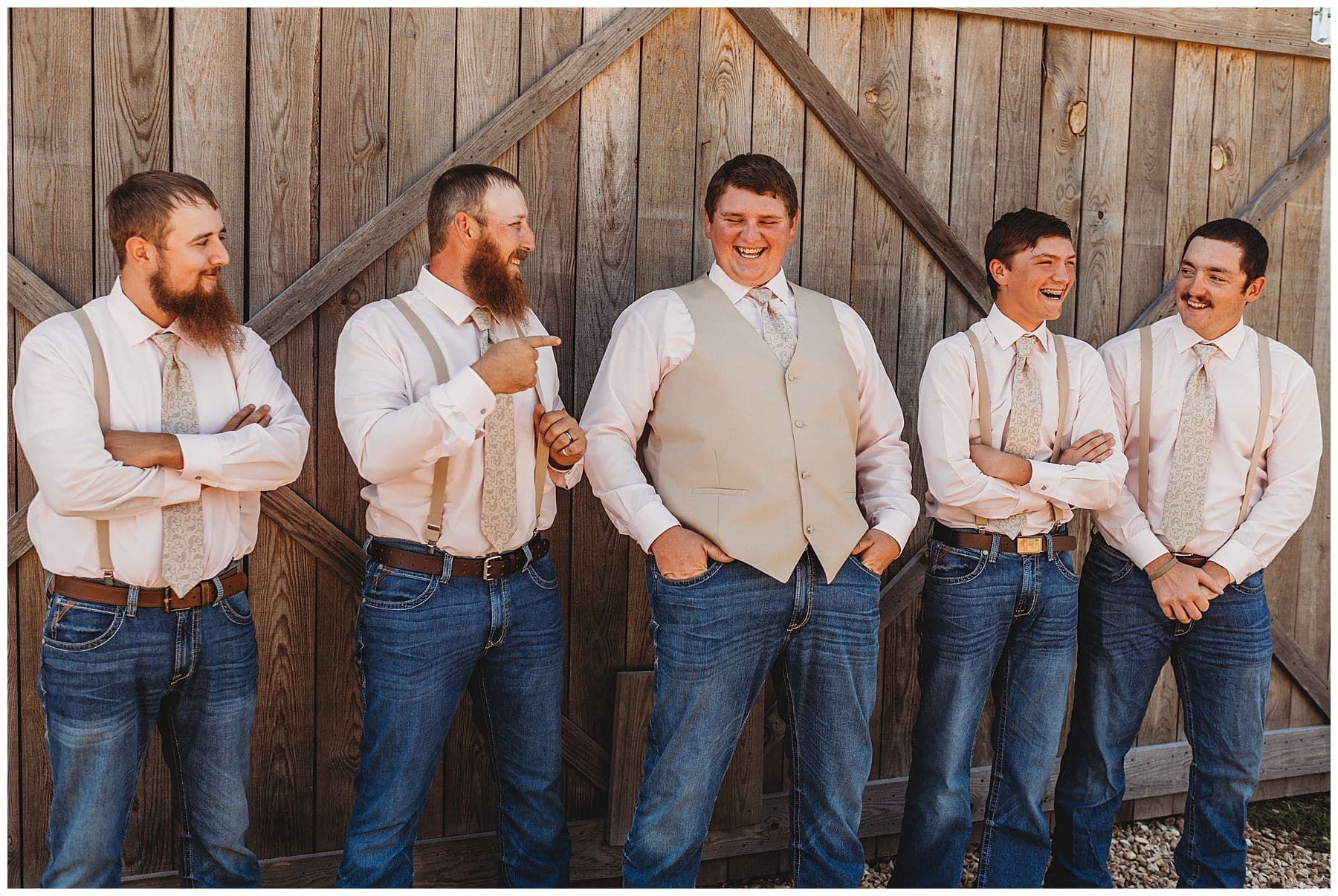 groom laughing with groomsmen