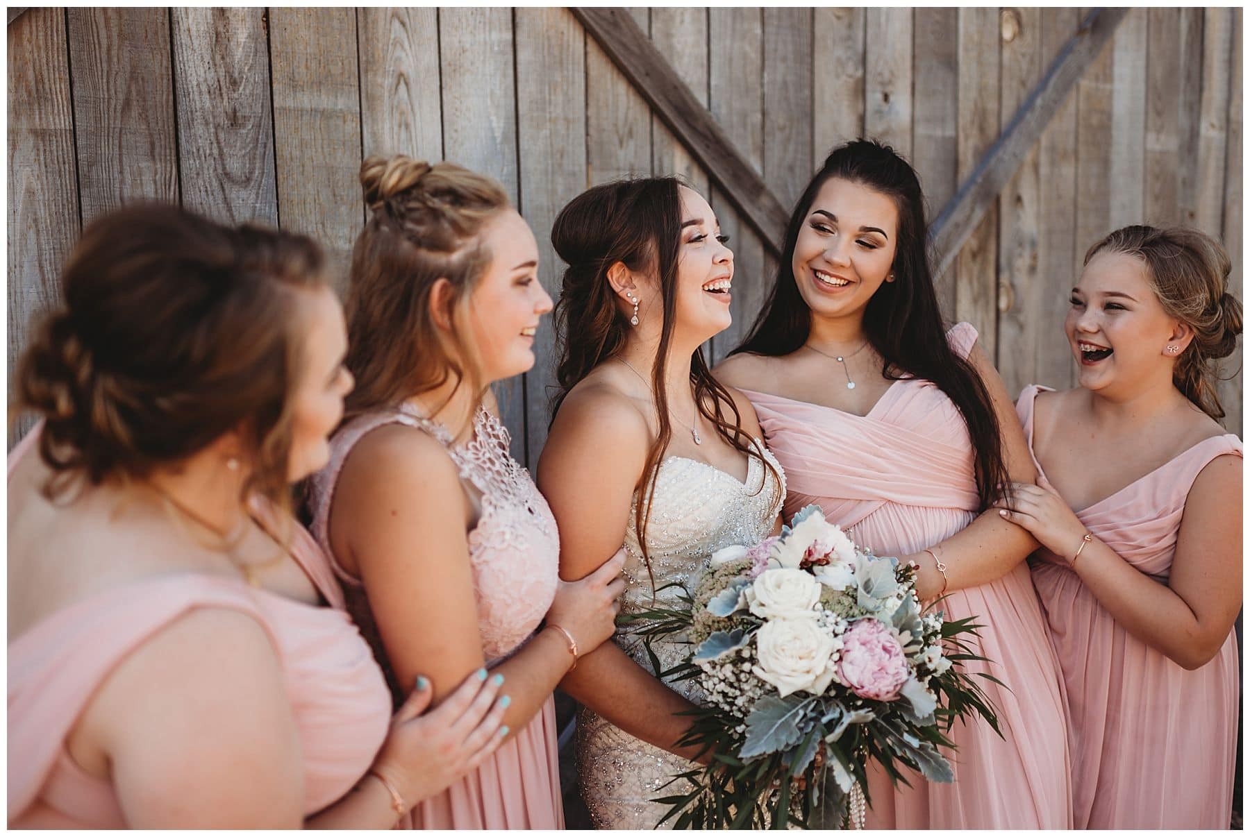 bride laughing with bridesmaids at Bonita Valley