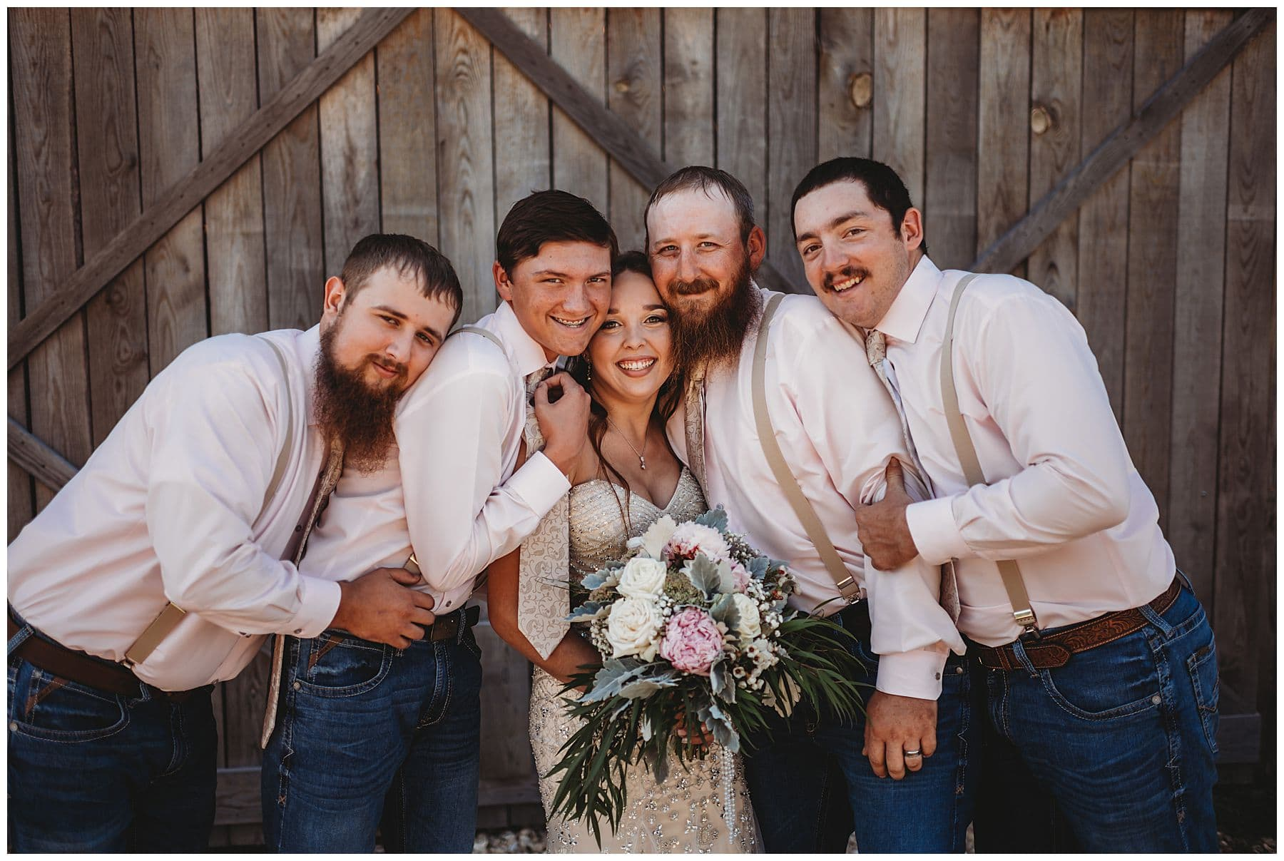 groomsmen hugging bride