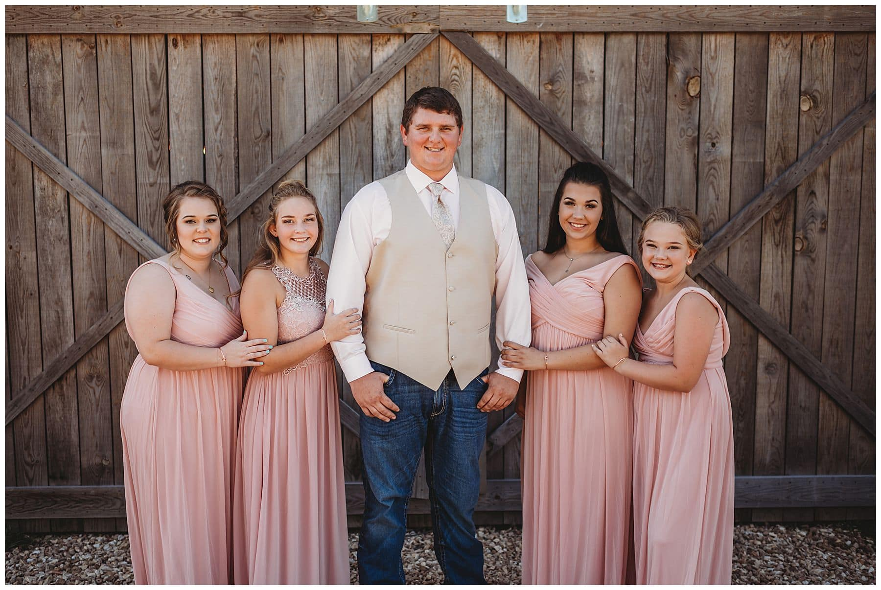 bridesmaids with groom