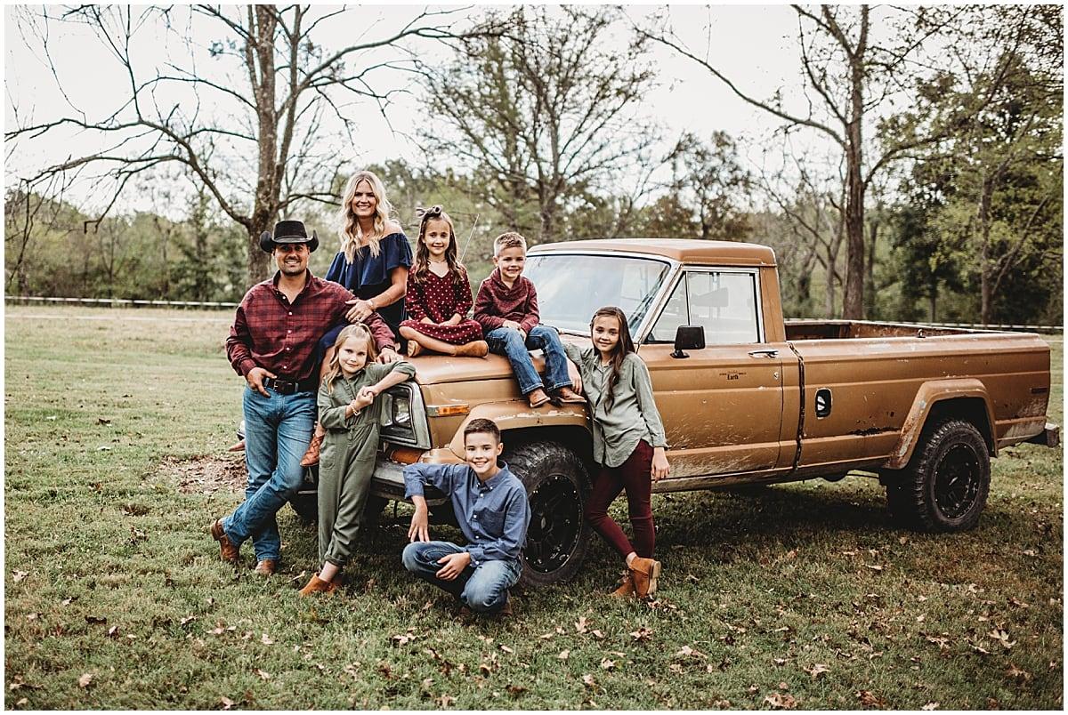 family sitting on truck