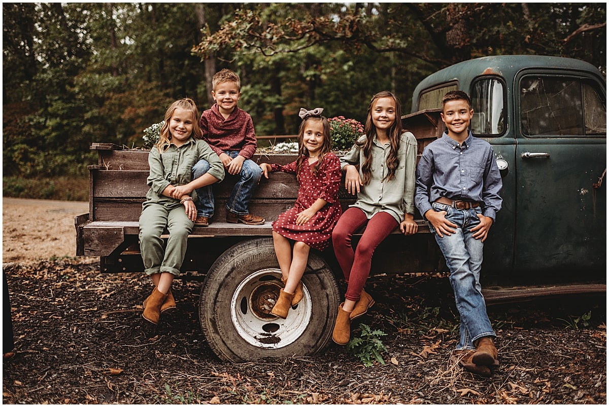 kids sitting on truck